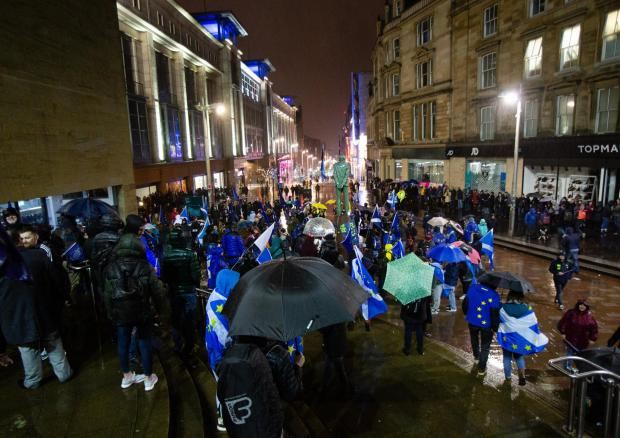 The National: People gathered in Glasgow to mark Brexit