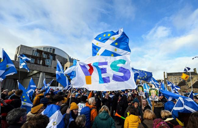 Activists attend an anti-Conservative government, pro-Scottish independence, and anti-Brexit demonstration outside Holyrood, the seat of the Scottish Parliament in Edinburgh on February 1, 2020. - Britain began its post-Brexit uncertain future outside the