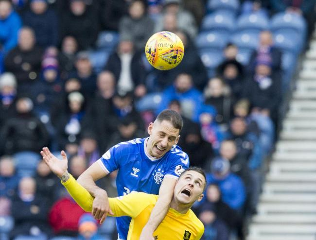 Nikola Katic (top) and Livingston's Lyndon Dykes battle for the ball during the Ladbrokes Scottish Premiership match at Ibrox