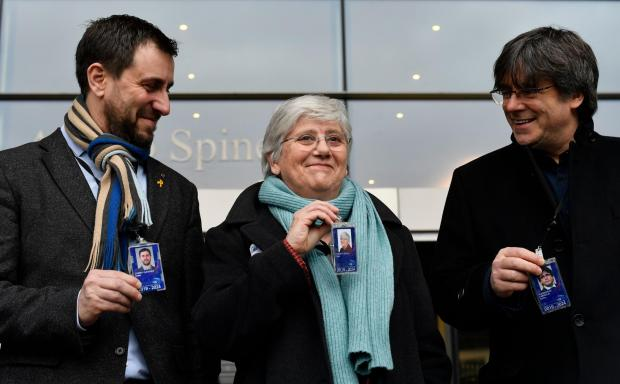 The National: From left, Toni Comin, Clara Ponsati, and Carles Puigdemont celebrate taking their places as MEPs