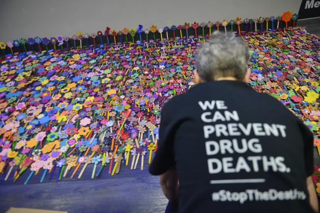 Paper flowers are laid to represent drug deaths at the Scottish Drug Deaths Crisis Conference at the SEC