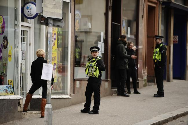 GLASGOW, SCOTLAND - MARCH 24: Police talk to people in the city centre during the Covid-19 Coronavirus pandemic lockdown on March 24, 2020 in Glasgow, Scotland. The UK and devolved governments have mandated that everyone apart from key workers stay in the