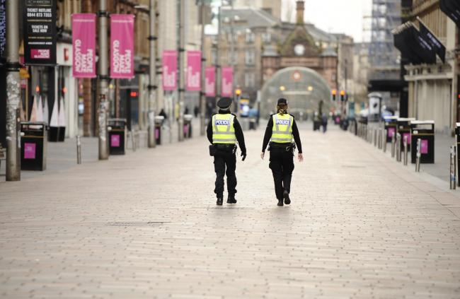 Police patrol Glasgow city centre during the coronavirus pandemic lockdown
