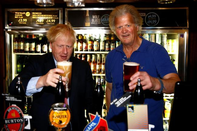 Wetherspoons boss Tim Martin, pictured with Boris Johnson, has come under fire for his treatment of staff during the coronavirus crisis