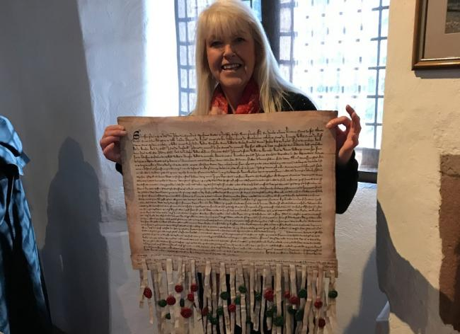 Lesley Riddoch with a replica of the Declaration from the film