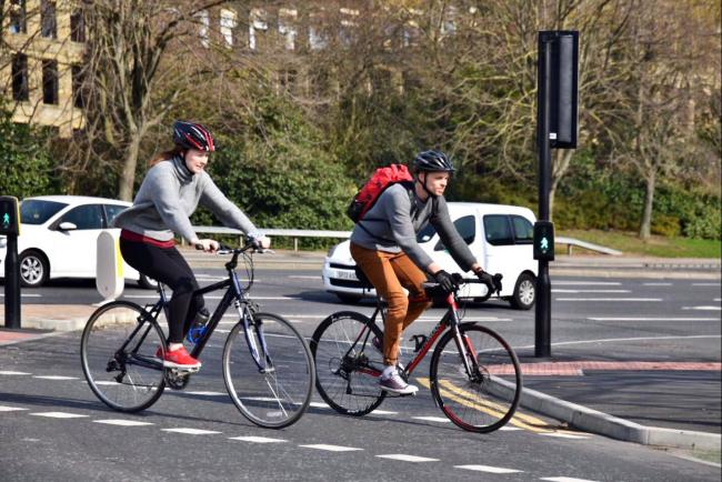 A campaign group is calling for reallocation of road space to ensure people walking and cycling can stay 2m apart