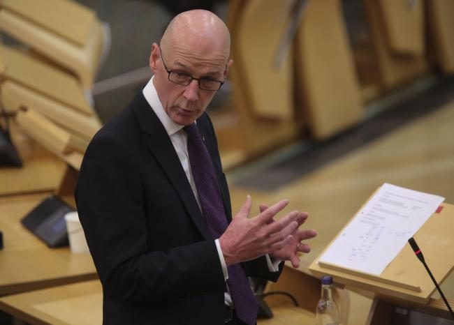 It seems Deputy First Minister and Education Secretary John Swinney is damned if he does and damned if he doesn't