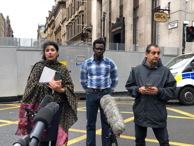 Robina Qureshi from Positive Action In Housing, Andrew (no last name given) an asylum seeker and Mohammad Asif speak to the media in Glasgow about the asylum seeker 'accommodation crisis'