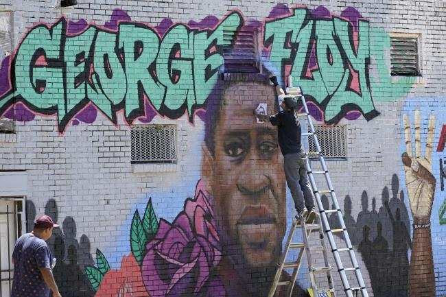 A mural depicting George Floyd, who was killed as a result of police brutality in America this year
