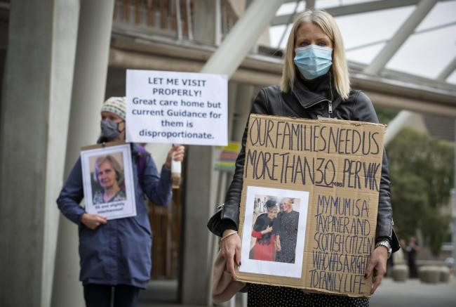 A demonstration outside the Scottish Parliament in September called for changes to the rules around care home visits