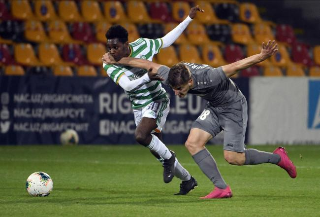Riga's Marko Djurisic, right, challenges for the ball with Celtic's Jeremie Frimpong. Photo: AP Photo/Roman Koksarov.