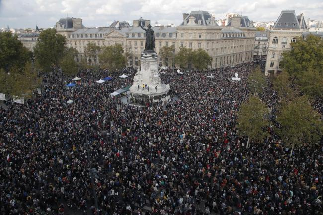 Hundreds of people gather on Republique square during a demonstration Sunday Oct. 18, 2020 in Paris. Demonstrations around France have been called in support of freedom of speech and to pay tribute to a French history teacher who was beheaded near Paris a