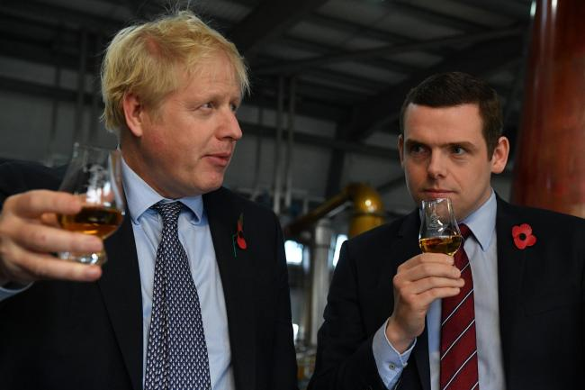 Boris Johnson with Douglas Ross last year during campaigning in Scotland
