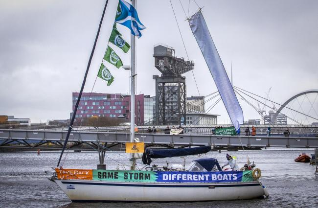 Protesters have sailed into Glasgow to highlight that we are in 'the same storm, but not the same boat'