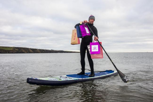 Jim Wight, owner of Sup2summit paddleboards with some locally bought presents. Picture: Alan Richardson