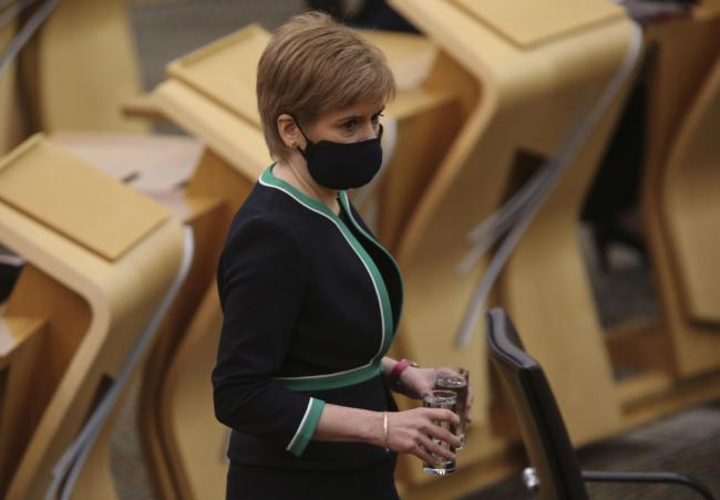 Nicola Sturgeon, pictured here in Holyrood, was photographed at a funeral with her mask off briefly. She apologised for the breach of mask rules
