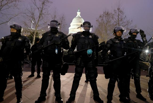 Police officers in riot gear line up as protesters gather at the US Capitol Building. Photograph: Getty
