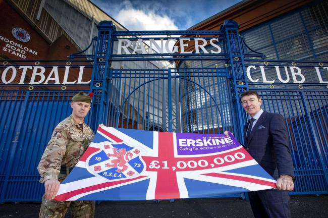 Black Watch squaddie Callum Robson and RSEA president Gordon Smith display their £1,000,000 banner outside the gates of Ibrox