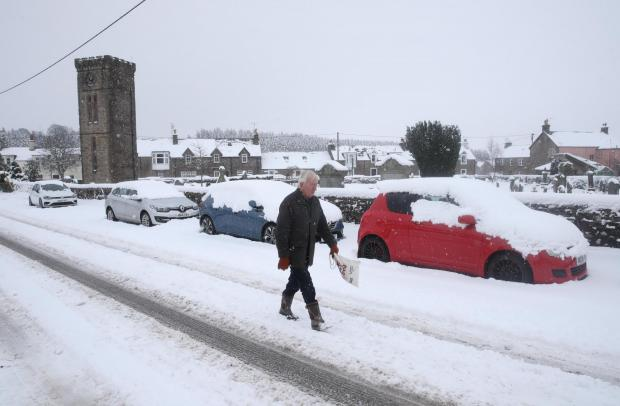The National: A man walking in the snow in Braco, near Dunblane.