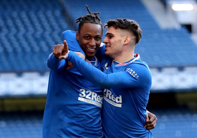 Rangers' Joe Aribo (left) celebrates scoring their side's third goal of the game during the Scottish Premiership match at Ibrox