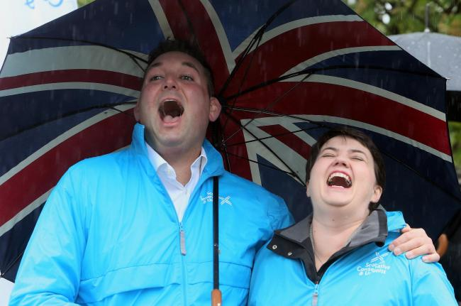 Miles Briggs, pictured with Scottish Tory Holyrood leader Ruth Davidson, has been branded a 'shameless hypocrite'