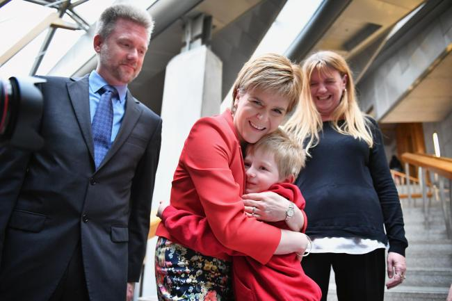 Gregg, Kathryn and Lachlan Brain meet Scotland's First Minister Nicola Sturgeon at the Scottish Parliament garden lobby on May 26, 2016