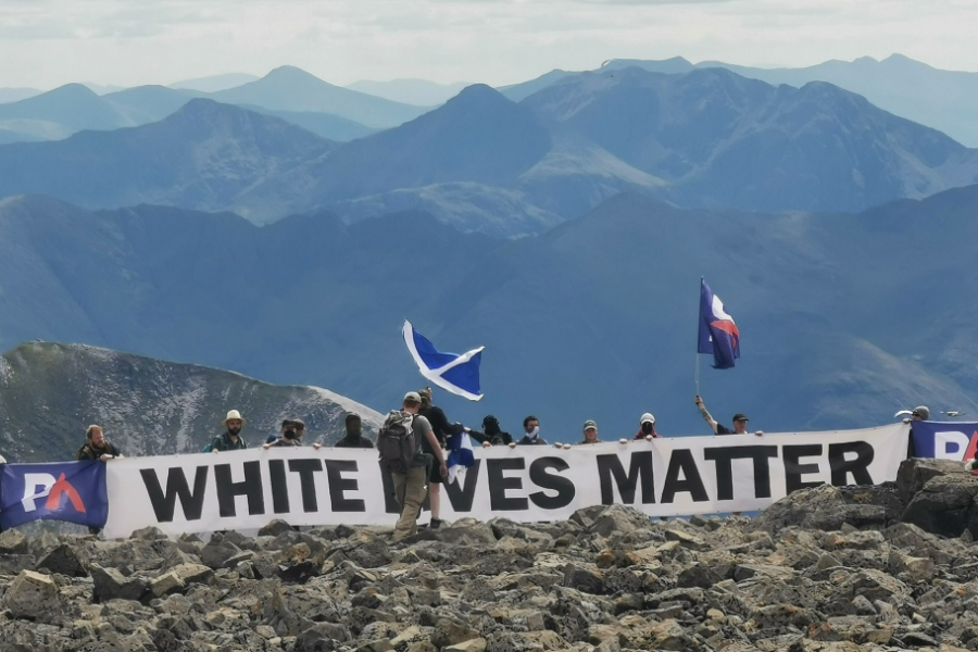 Witnesses boo as far-right group unveils 'abhorrent' banner at Ben Nevis summit