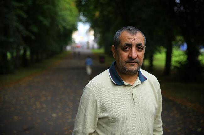 Mohammad Asif, chair of the Afghan Human Rights Foundation pictured in the Southside of Glasgow. Photograph: Colin Mearns