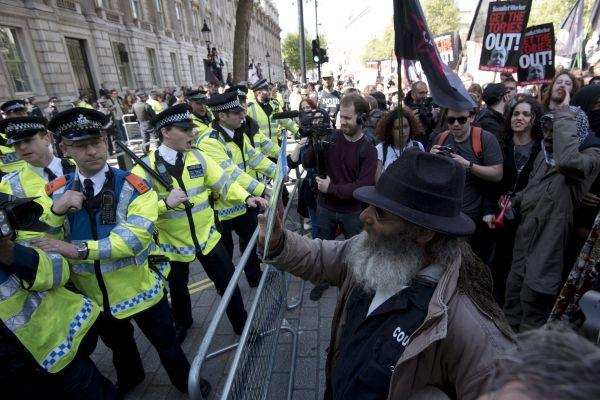 Police hold back protesters in Downing Street at the weekend