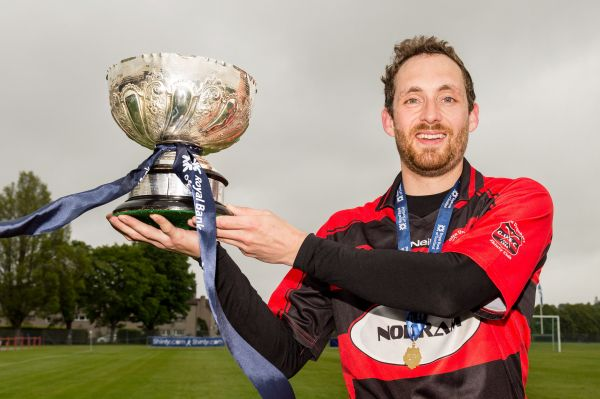 Glen captain Andrew Corrigan with the RBS MacTavish Cup