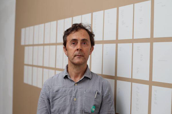 Alec Finlay with his work A Better Tale To Tell which is made up of submissions to the Smith Commission