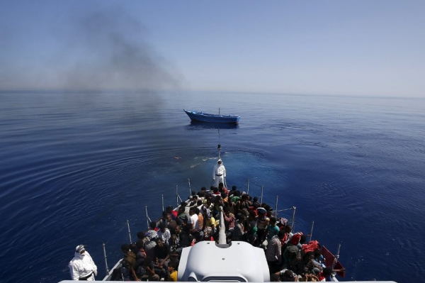 A group of 300 sub-Saharan Africans sit on board the Italian Finance Police vessel Di Bartolo as their boat is left to adrift off the coast of Sicily in May this year