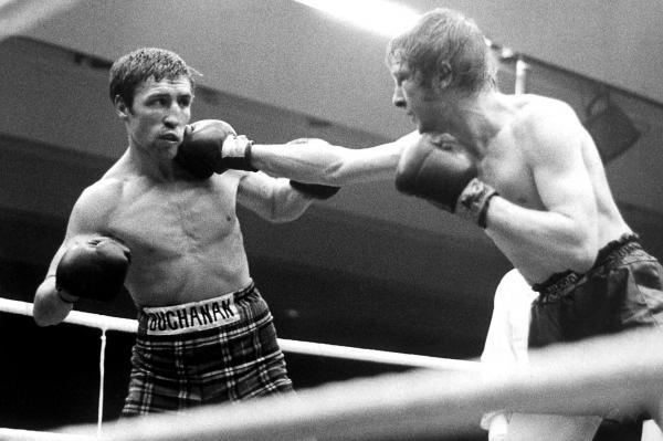 Jim Watt, right, lands a right jab on fellow Scottish great Ken Buchanan in their battle for the British lightweight title in 1973, which Buchanan eventually won on points