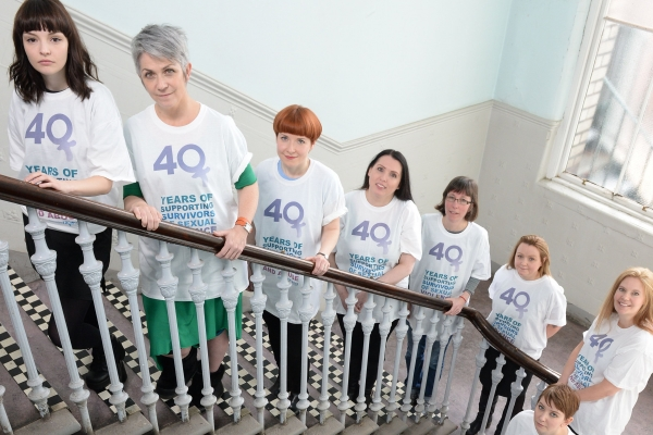 Chvrches singer Lauren Mayberry, left, and author Dame Denise Mina, second left, with Glasgow Rape Crisis staff and volunteers at the launch of the £40 for 40 Years fundraising campaign Photograph: Kirsty Anderson