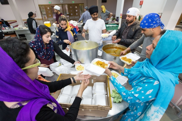 Volunteers work with the Seva Scotland soup kitchen