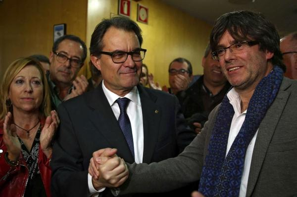 Catalonia's regional president Carles Puigdemont, right, with former president Artur Mas