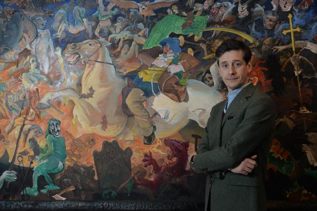 Lachlan Goudie at a canvas depicting one stanza of Tam o'Shanter painted by his late father, the Paisley artist Alexander Goudie