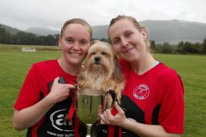 Shinty evangelist Joy Elliott-Bowman, right, with wife Bernie and their dog Ronan