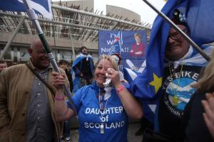 Independence supporters take part in a rally outside the Scottish Parliament during yesterday's Section 30 vote