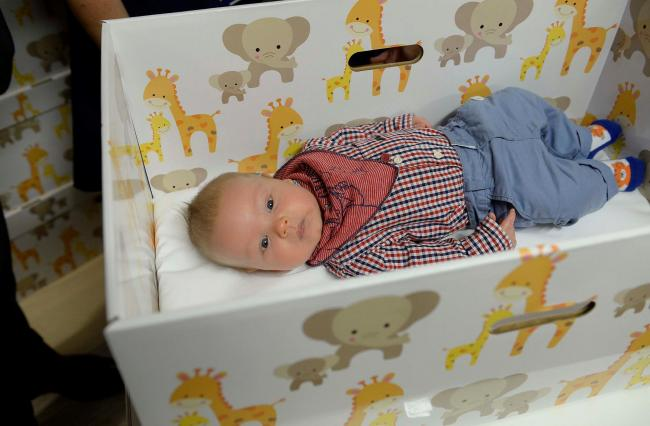 Some parents now receive a baby box for their newborn. Photograph: Steve Brading