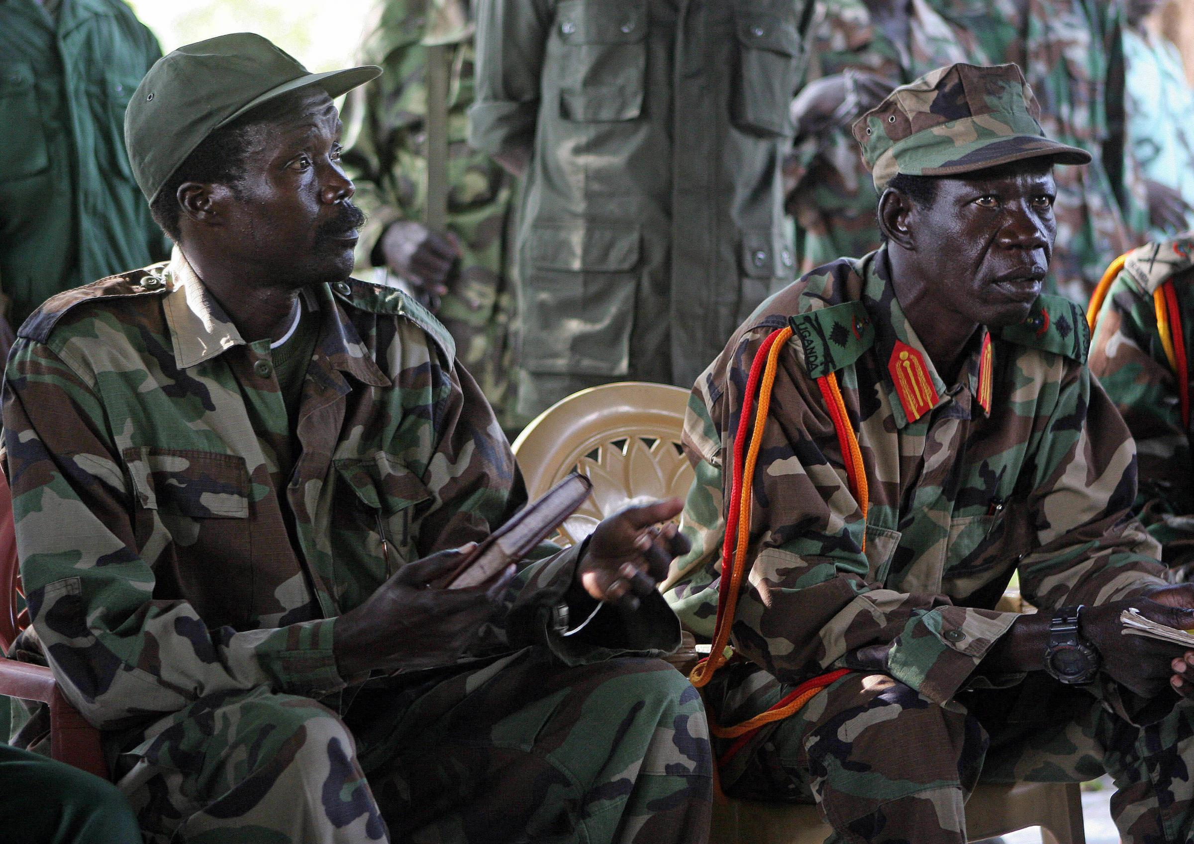 Joseph Kony, left, and his deputy Vincent Otti sit inside a tent at Ri-Kwangba in Southern Sudan