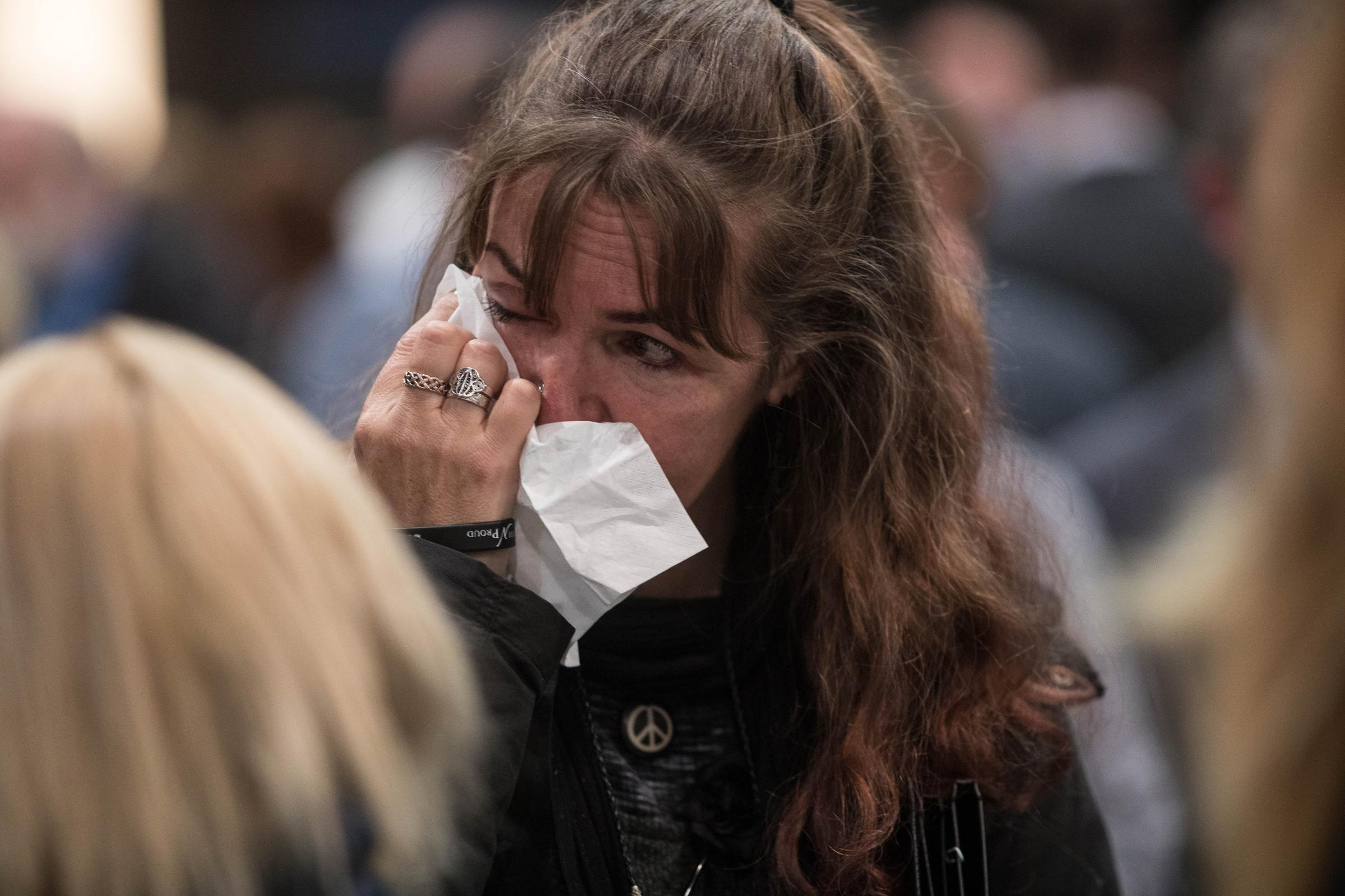 An SNP activist wipes away tears at the count in Aberdeen
