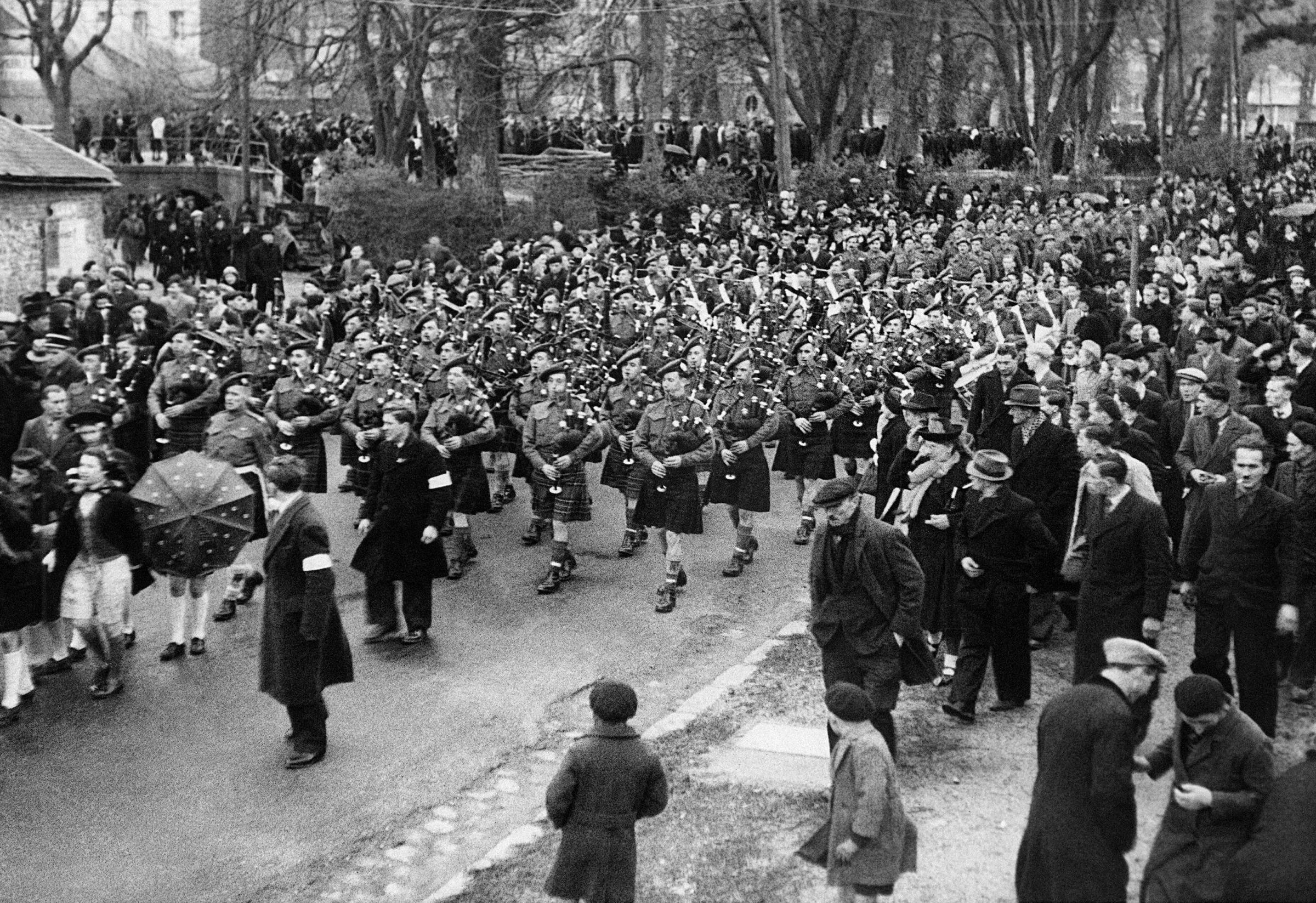The re-formed 51st Highland Division back in Saint-Valery-en-Caux in 1944. Thousands of their number were captured in the French town four years earlier