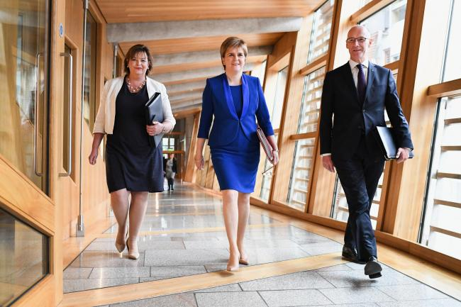 The First Minister with John Swinney and Fiona Hyslop ahead of her Holyrood speech. Photograph: Getty