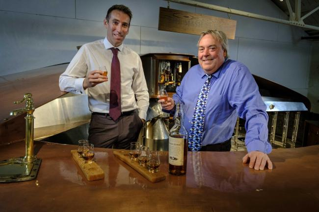 Diageo Scotland director Ewan Andrew and Malcolm Roughead, VisitScotland chief, at the Blair Atholl distillery's new whisky tasting bar
