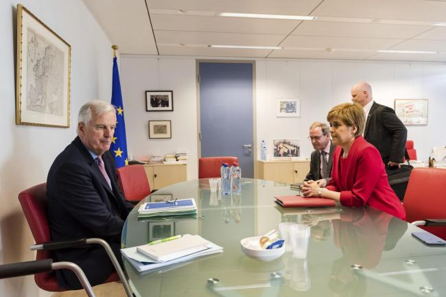Sturgeon told Michel Barnier, left, that the Scottish Government would build a consensus against an extreme Brexit outside the single market