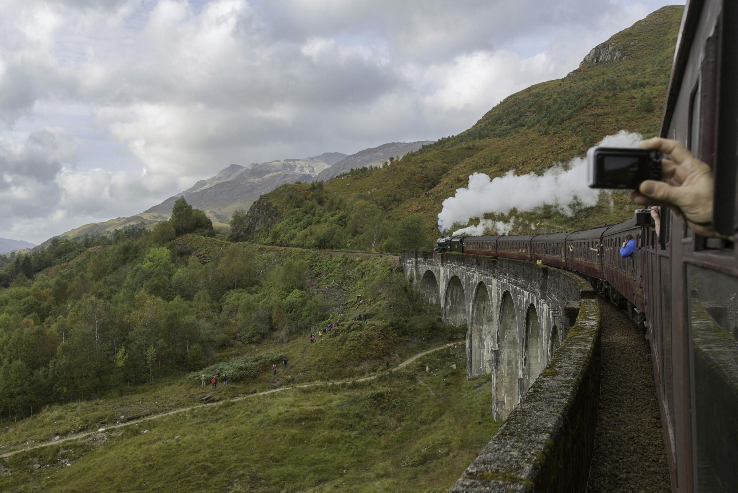 A steam train makes its way along the Glenfinnan Viaduct on the West Highland Line. Photograph: PA