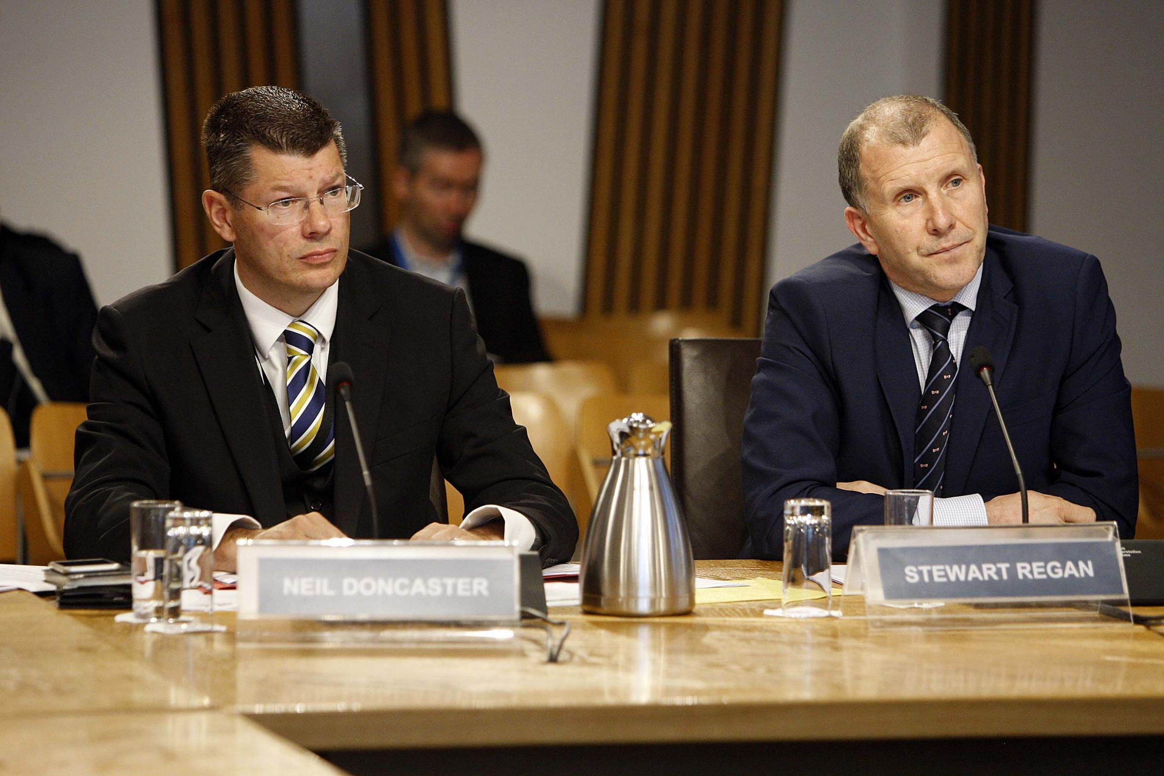 Neil Doncaster, Chief Executive, Scottish Professional Football League, left, and Stewart Regan, Chief Executive, Scottish Football Association, right