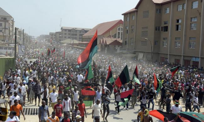 Pro-Biafra supporters wave flags in the streets of Aba, Nigeria