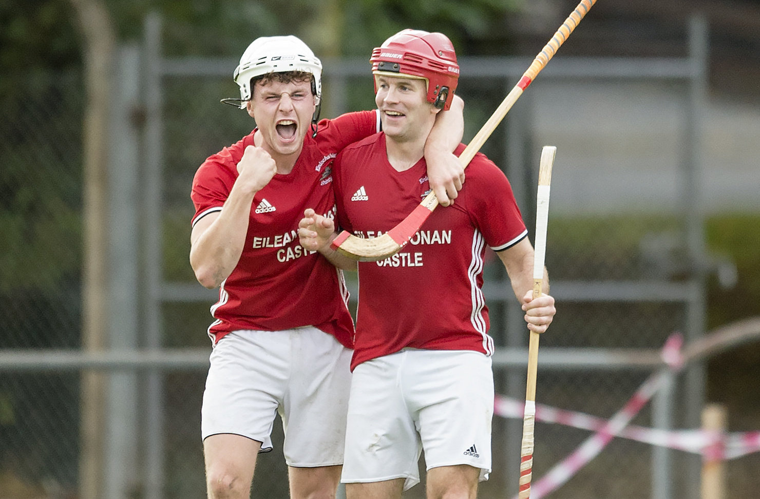 Kinlochshiel's Keith Macrae, right, celebrates his goal against Oban Camanachd with Oliver Macrae